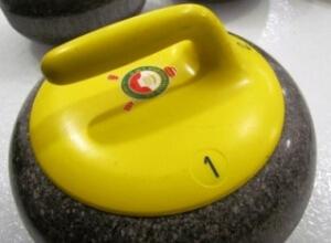 rocks with logo on yellow handle - Copy